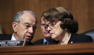 Senate Judiciary Committee Chairman Sen. Charles Grassley of Iowa, confers with ranking member, Sen. Dianne Feinstein of California during a hearing on Capitol Hill in Washington, Wednesday, Sept. 6, 2017, regarding Eric Dreiband's nomination to be Assistant Attorney General, Civil Rights Division. (AP Photo/Manuel Balce Ceneta) ** FILE **