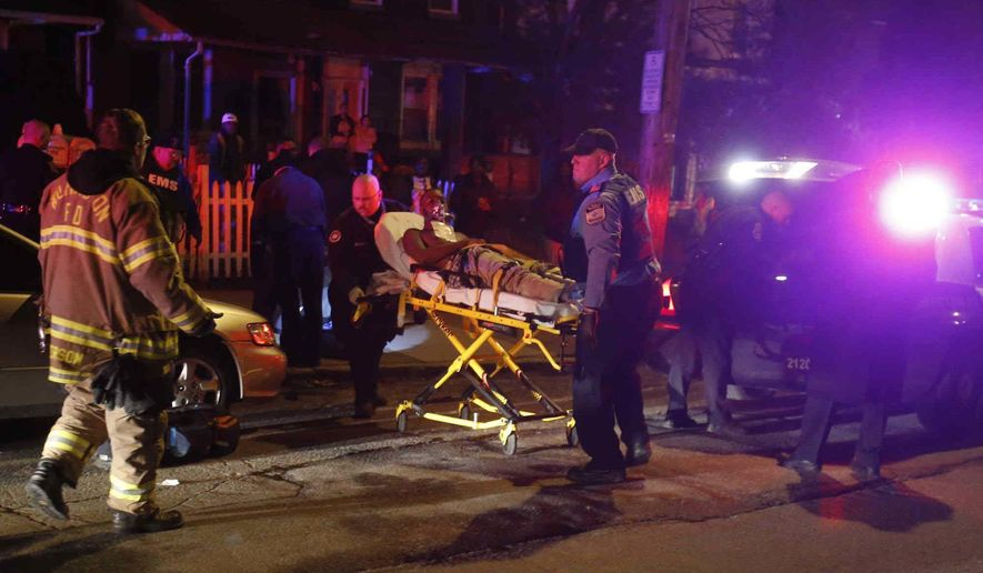 ADVANCE FOR USE FRIDAY, SEPT. 8, 2017 AND THEREAFTER-In this Friday, Jan. 15, 2015 photo, emergency workers use a stretcher to bring a shooting victim into an ambulance at West 4th and Broom Streets in Wilmington, Del., after gunshots claimed multiple victims. A 16-year-old who had been shot in the head died at the hospital, according to police. (William Bretzger/The Wilmington News-Journal via AP)