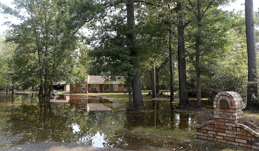 Homes west of River Road remain flooded as residents begin the task of gutting and trying to restore their homes. The community was cleared for entry as flood waters have receded to safer levels throughout the majority of the community, Wednesday, Sept. 6, 2017 in Bevil Oaks, Texas. (Kim Brent/The Beaumont Enterprise via AP)