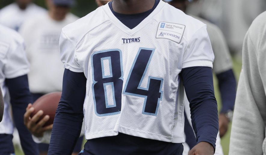 In this June 15, 2017 photo, Tennessee Titans wide receiver Corey Davis leaves the field following NFL football minicamp in Nashville, Tenn. Davis insists he's healthy and eager to take his first snap in an NFL game. Thanks to a hamstring injury, that will come Sunday in the Titans' season opener against Oakland after Tennessee made sure the first wide receiver drafted in April is fully recovered. (AP Photo/Mark Humphrey)