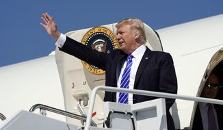 President Donald Trump waves during his arrival at Bismark Municipal Airport, Wednesday, Sept. 6, 2017 in Bismark, N.D. Trump is in North Dakota to promote his tax overhaul plan. (AP Photo/Pablo Martinez Monsivais)