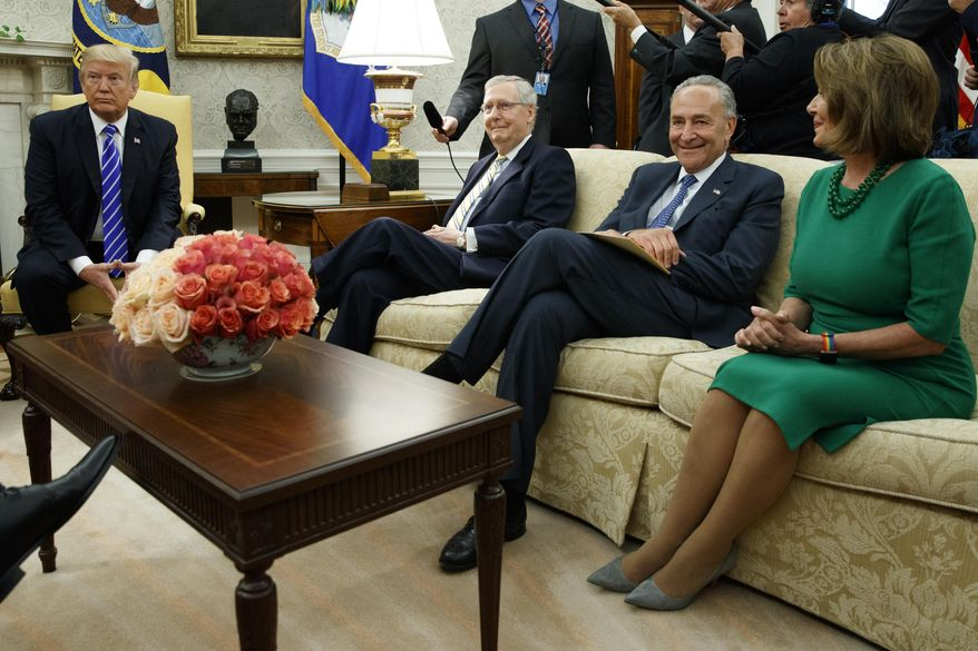 President Donald Trump pauses during a meeting with, from left, Senate Majority Leader Mitch McConnell, R-Ky., Senate Minority Leader Chuck Schumer, D-N.Y., House Minority Leader Nancy Pelosi, D-Calif., and other Congressional leaders in the Oval Office of the White House, Wednesday, Sept. 6, 2017, in Washington. Trump overruled congressional Republicans and his own treasury secretary Wednesday and cut a deal with Democrats to fund the government and raise the federal borrowing limit for three months, all part of an agreement to speed money to Harvey relief. (AP Photo/Evan Vucci)