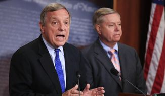 Sen. Dick Durbin, D-Ill., left, with Sen. Lindsey Graham, R-S.C., speaks during a news conference on Capitol Hill in Washington, Tuesday, Sept. 5, 2017, to discuss their bipartisan Dream Act, which would allow young immigrants who grew up in the United States to earn lawful permanent residence and eventually American citizenship. (AP Photo/Manuel Balce Ceneta)