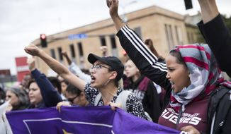 From left, June Kuoch, 20, and Shamsa Ahmed, 18 march during a protest against the announcement that the Trump administration is ending the Deferred Action for Childhood Arrivals program, known as DACA, in Minneapolis, Tuesday, Sept. 5, 2017. (Renee Jones Schneider/Star Tribune via AP)