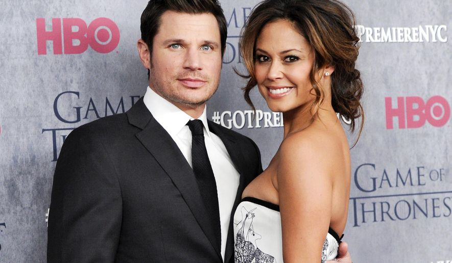 "FILE - This March 18, 2014 file photo shows television personalities Nick Lachey, left, and his wife Vanessa Lachey at HBO's ""Game of Thrones"" fourth season premiere in New York. ABC announced Sept. 6, 2017, that the couple will compete on the upcoming season of ""Dancing with the Stars."" (Photo by Evan Agostini/Invision/AP, File)"