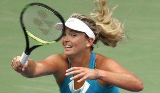 CoCo Vandeweghe, of the United States, returns a shot to Karolina Pliskova, of Czech Republic, during the quarterfinals of the U.S. Open tennis tournament, Wednesday, Sept. 6, 2017, in New York. (AP Photo/Adam Hunger)