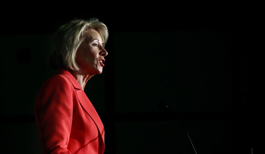 """Education Secretary Betsy DeVos speaks Thursday, Sept. 7, 2017, at George Mason University Arlington, Va., campus. DeVos on declared that """"the era of 'rule by letter' is over"""" as she announced plans to change the way colleges and university handle allegations of sexual violence on campus. (AP Photo/Jacquelyn Martin)"""
