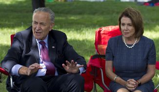 Senate Minority Leader Chuck Schumer of N.Y., accompanied by House Minority Leader Nancy Pelosi of Calif. speaks with people who are holding a 4-day fast on Capitol Hill in Washington, Thursday, Sept. 7, 2017. House and Senate Democrats gather to call for Congressional Republicans to stand up to President Trump's decision to terminate the Deferred Action for Childhood Arrivals (DACA) initiative by bringing the DREAM Act for a vote on the House and Senate Floor. ( AP Photo/Jose Luis Magana)