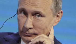 "Russian President Vladimir Putin addresses a plenary session titled ""The Russian Far East: Creating a New Reality"" at the Eastern Economic Forum in Vladivostok, Russia, on Thursday, Sept. 7, 2017. Russian President Putin says he believes President Donald Trump's administration is willing to defuse tensions on the Korean Peninsula. (Sergei Bobylev/TASS News Agency Pool Photo via AP)"