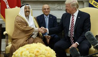 President Donald Trump shakes hands with Amir of Kuwait Sheikh Sabah Al Ahmad Al Saba during a meeting in the Oval Office of the White House, Thursday, Sept. 7, 2017, in Washington. (AP Photo/Evan Vucci)