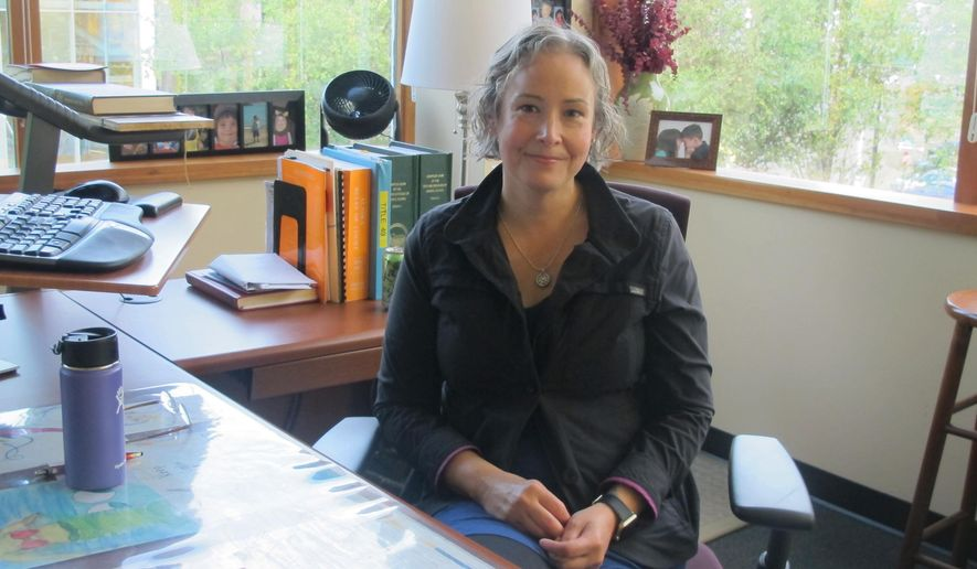 In this Wednesday, Sept. 6, 2017 photo, Amy Mead, municipal attorney for the City and Borough of Juneau, poses in her office in Juneau, Alaska. The city is planning a one-year pilot program aimed at addressing repeat shoplifters. (AP Photo/Becky Bohrer)