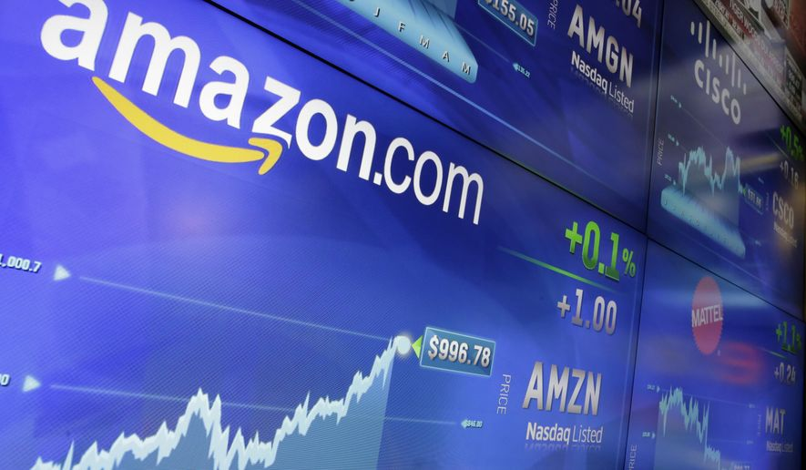In this Tuesday, May 30, 2017, file photo, the Amazon logo is displayed at the Nasdaq MarketSite, in New York's Times Square. Amazon announced Thursday, Sept. 7, that it has opened the search for a second headquarters, promising to spend more than $5 billion on the opening. (AP Photo/Richard Drew, File)