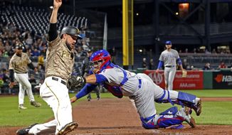 Chicago Cubs catcher Rene Rivera makes makes the tag on Pittsburgh Pirates' Jordy Mercer for the out at home plate during the second inning of a baseball game Thursday, Sept. 7, 2017, in Pittsburgh. (AP Photo/Gene J. Puskar)