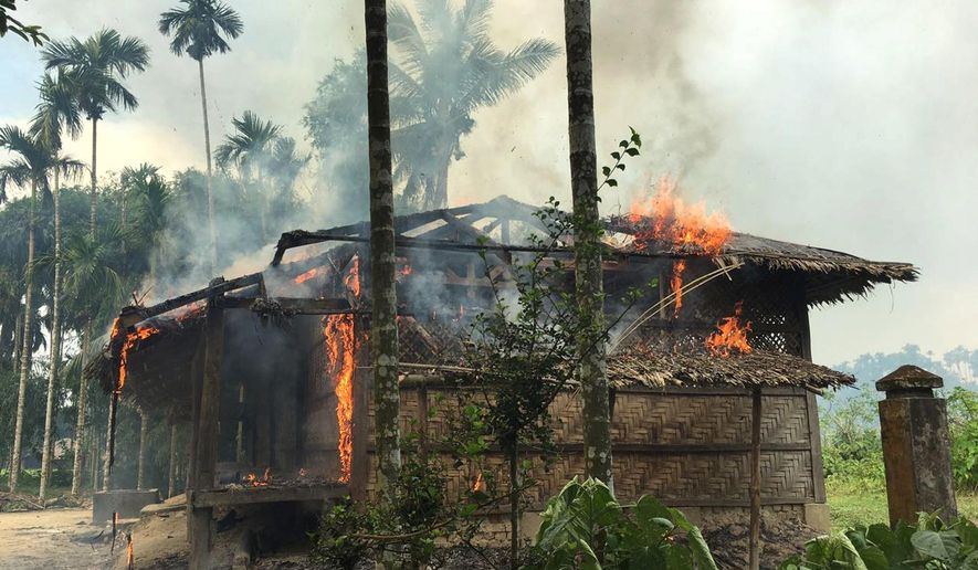 Houses are on fire in Gawdu Zara village, northern Rakhine state, Myanmar, Thursday, Sept. 7, 2017. Journalists saw new fires burning Thursday in the Myanmar village that had been abandoned by Rohingya Muslims, and where pages from the Quran were seen ripped and left on the ground. (AP Photo)