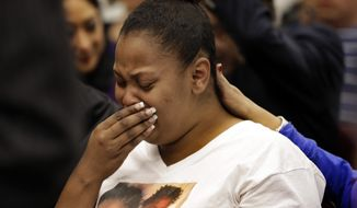 FILE - In this Dec. 20, 2013 file photo, Nailah Winkfield, mother of 13-year-old Jahi McMath, cries before a courtroom hearing regarding McMath, in Oakland, Calif. A California judge ruled that McMath, a teen girl declared brain dead more than three years ago after a tonsillectomy, may still be technically alive, allowing a malpractice lawsuit against the hospital to proceed. (AP Photo/Ben Margot, File)