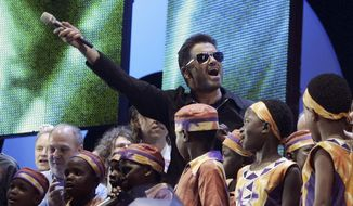 "FILE - In this Saturday, July 2, 2005 file photo, British singer George Michael accompanied by other musicians and children from Africa gestures to the crowds during the Live 8 concert in Hyde Park, London. A new single by George Michael has been released, eight month after the music star's death. ""Fantasy,"" first recorded in the late 1980s, has been reworked by funk-master Nile Rodgers and received its first radio airplay on Thursday, Sept. 7, 2017. Rodgers tweeted that he felt ""emotional ambiguity"" about the song, which evoked ""tears, uncertainty, happiness and love."" (AP Photo/Lefteris Pitarakis, File)"
