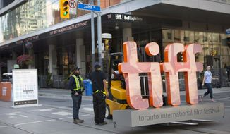 A sign bearing the Toronto International Film Festival logo sits on a fork lift as preparations are made for the festival's opening night on Thursday Sept. 7, 2017.  (Chris Young/The Canadian Press via AP)