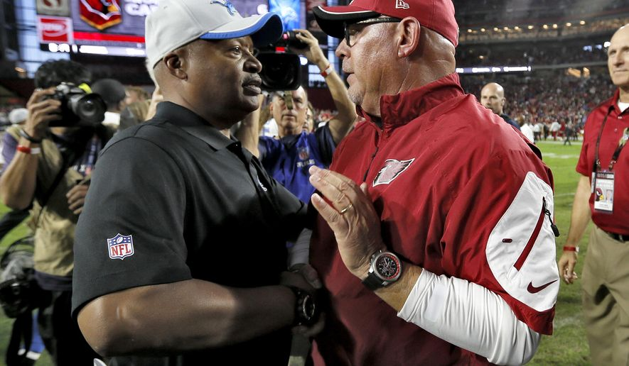 FILE - In this Nov. 16, 2014, file photo, Arizona Cardinals head coach Bruce Arians, right, greets Detroit Lions head coach Jim Caldwell after an NFL football game in Glendale, Ariz. The Lions finally get a chance to bounce back from a year they would like to forget. The Cardinals, likewise, are looking forward to moving on from a disappointing season. (AP Photo/Ralph Freso, File)
