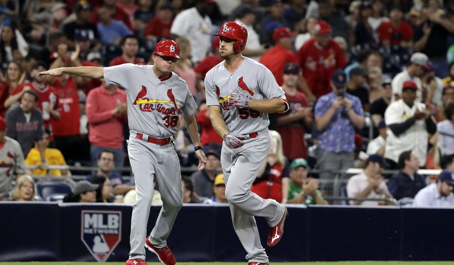 St. Louis Cardinals' Stephen Piscotty, right, is greeted by St. Louis Cardinals third base coach Mike Shildt after hitting a two-run home run during the seventh inning of a baseball game against the San Diego Padres on Wednesday, Sept. 6, 2017, in San Diego. (AP Photo/Gregory Bull)