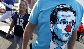 A fan wears a T-shirt bearing the face of NFL Commissioner Roger Goodell while tailgating in the parking lot of Gillette Stadium before a football game between the New England Patriots and the Kansas City Chiefs, Thursday, Sept. 7, 2017, in Foxborough, Mass. (AP Photo/Michael Dwyer)