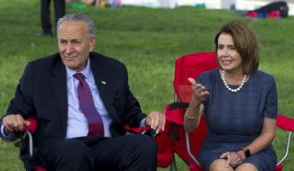 House Minority Leader Nancy Pelosi of California and Senate Minority Leader Chuck Schumer of New York speak with Dreamers who are holding a four-day fast on Capitol Hill in Washington, Thursday, Sept. 7, 2017. (AP Photo/Jose Luis Magana)