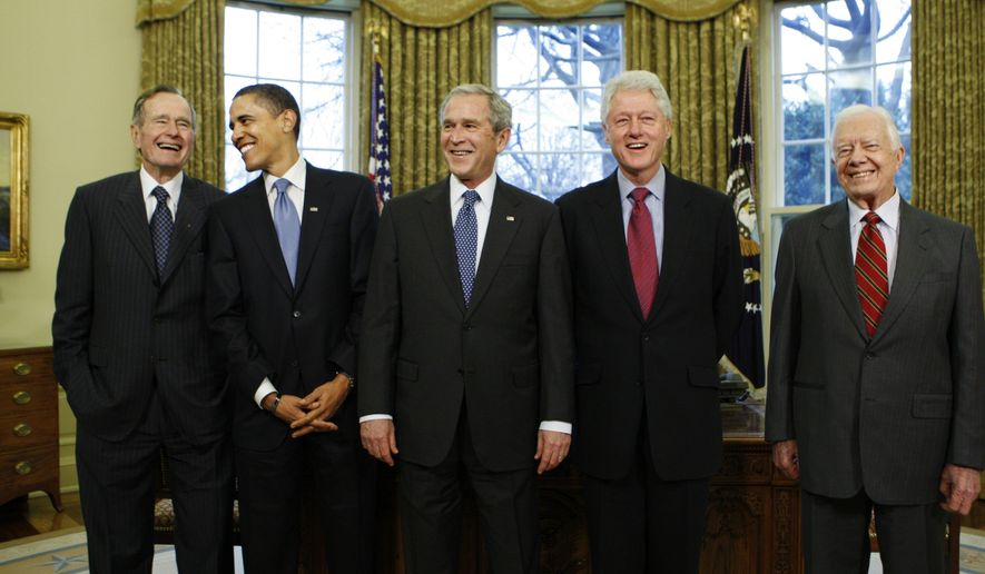 "In this Jan. 7, 2009, file photo, then-President-elect Barack Obama is welcomed by then-President George W. Bush for a meeting at the White House in Washington, Wednesday, Jan. 7, 2009, with former presidents, from left, George H.W. Bush, Bill Clinton and Jimmy Carter. The five living former U.S. presidents are creating the ""One America Appeal"" to raise money for storm recovery as Texas and Louisiana regroup from Harvey and Florida braces for Hurricane Irma. (AP Photo/J. Scott Applewhite, File)"