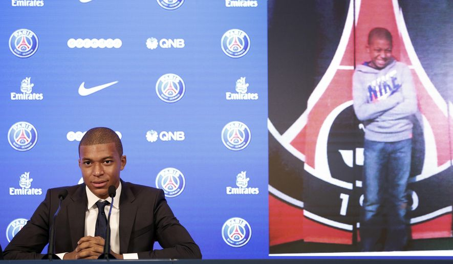 """French soccer player Kylian Mbappe attends a press conference in Paris, Wednesday, Sept. 6, 2017. Mbappe is a young man in a big hurry and wants to """"win everything"""" with his new club Paris Saint-Germain. (AP Photo/Christophe Ena)"""