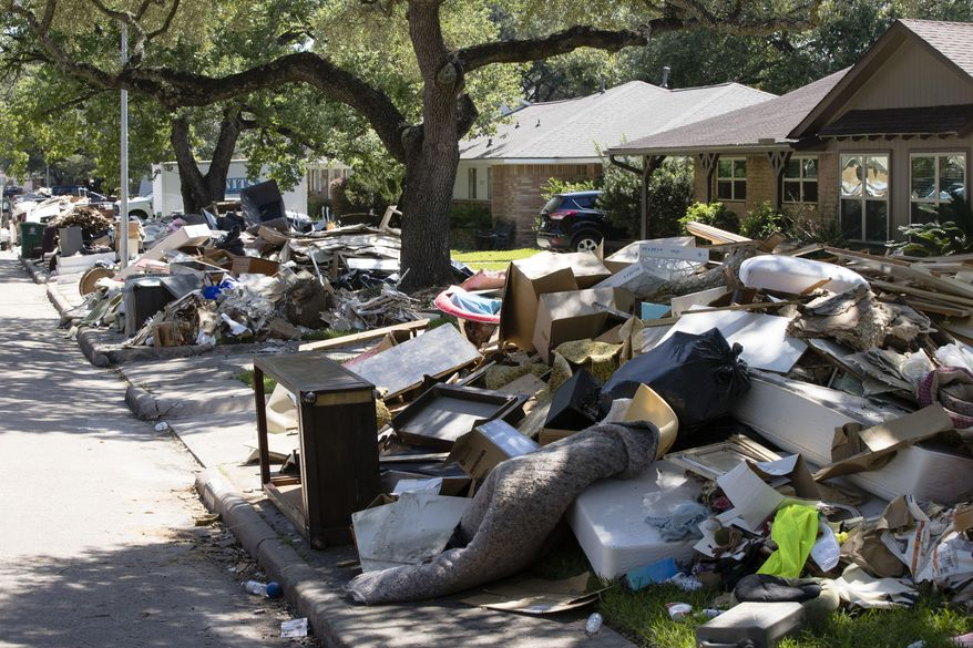 Flood damaged debris from homes lines the street in the aftermath of Hurricane Harvey on Thursday, Sept. 7, 2017, in Houston. (AP Photo/Matt Rourke)