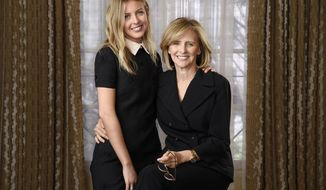 "In this Aug. 24, 2017 photo, Hallie Meyers-Shyer, left, writer/director of the film ""Home Again,"" poses for a portrait with her mother, the film's producer Nancy Meyers, at the Four Seasons Hotel in Los Angeles. The film hits theaters Friday, Sept. 8, and stars Reese Witherspoon as a recently separated mother of two who moves back to Los Angeles and starts dating a much younger man. (Photo by Chris Pizzello/Invision/AP)"