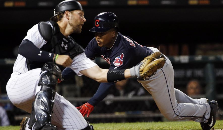 Cleveland Indians' Jose Ramirez, right, scores against Chicago White Sox catcher Kevan Smith during the ninth inning of a baseball game Wednesday, Sept. 6, 2017, in Chicago. The Indians won 5-1. (AP Photo/Nam Y. Huh)