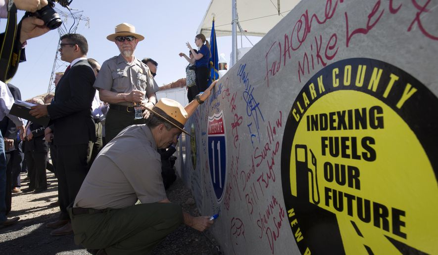 National Park Service rangers sign a box culvert that will be used in the Interstate 11/Boulder City Bypass project during a groundbreaking ceremony near Boulder City Monday, April 6, 2015. The $318 million project is expected to be completed in 2018 and create about 4,000 jobs. (Steve Marcus/Las Vegas Sun via AP)