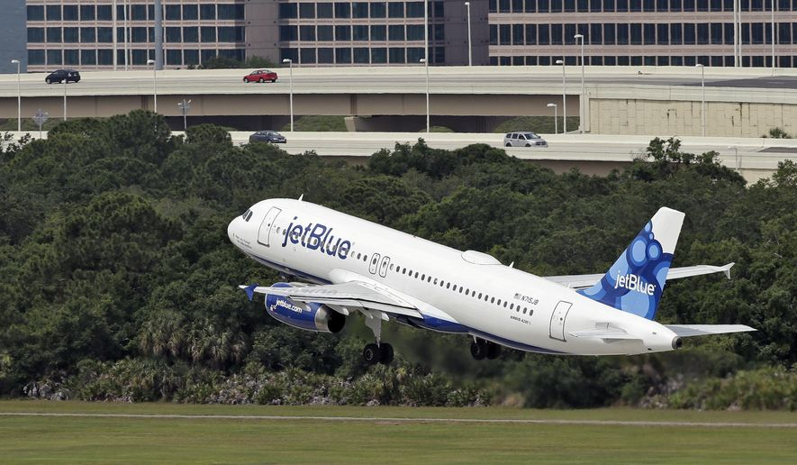 FILE - In this May 15, 2014, file photo, a JetBlue Airways Airbus A320-232 takes off from the Tampa International Airport in Tampa, Fla. Some airlines are adding flights leaving Florida as the crush to escape Irma causes a run on seats. Meanwhile, some consumers accuse the airlines of price-gouging. Several carriers responded by capping their fares from Florida.  (AP Photo/Chris O'Meara, File)