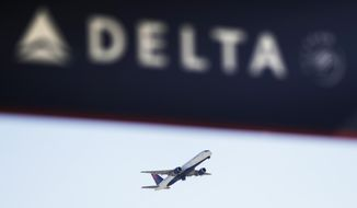 FILE - In this Jan. 30, 2017, file photo, a Delta Air Lines flight takes off from Hartsfield-Jackson Atlanta International Airport in Atlanta. A Delta plan flew in and out of San Juan, Puerto Rico, on Sept. 6, 2017, just before Hurricane Irma battered the island. (AP Photo/David Goldman, File)
