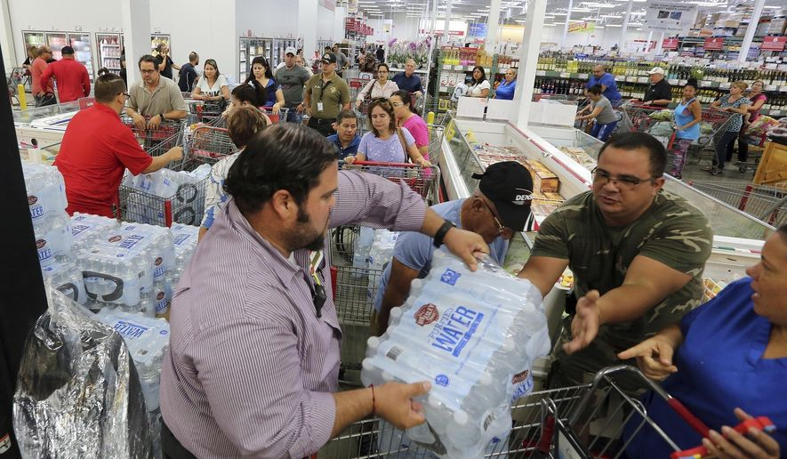 "FILE- This Sept. 5, 2017 file photo shows residents in a long line waiting to purchase water at BJ Wholesale in preparation for Hurricane Irma in Miami. With images of Hurricane Harvey's wrath in Texas still fresh and 25-year-old memories of Hurricane Andrew's destruction, warnings that Hurricane Irma might be the long-dreaded ""big one"" has brought many Floridians close to panic. Lines for gas, food and supplies stretched outside businesses as the South Florida region of more than 6 million people rushed to prepare for Irma, which forecasters say could strike over the weekend as a Category 4 or 5 storm. (Roberto Koltun/Miami Herald via AP, File)"