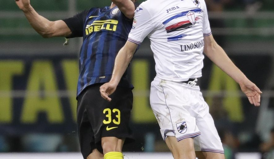 FILE - In this April 3, 2017 file photo, Inter Milan's Danilo D'Ambrosio , left, and Sampdoria's Patrik Schick jump for the ball during a Serie A soccer match between Inter Milan and Sampdoria, at the San Siro stadium in Milan, Italy. It has been a rapid rise for new Roma player Patrik Schick, who has gone from playing for a mid-level Czech team to a title-chasing Serie A side in just over a year.  (AP Photo/Antonio Calanni, file)