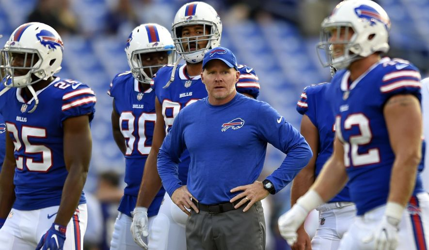 FILE - In this Aug. 26, 2017, file photo, Buffalo Bills coach Sean McDermott, center, stands on the field before the team's preseason NFL football game against the Baltimore Ravens in Baltimore. The Bills face the New York Jets on Sunday to open their season. The Bills have a new coach in McDermott, who takes over after Rex Ryan was fired in the final week of last season. They have a new general manager in Brandon Beane and an opening-day roster of just 22 players who appeared in a game for Buffalo last year. (AP Photo/Gail Burton, File)
