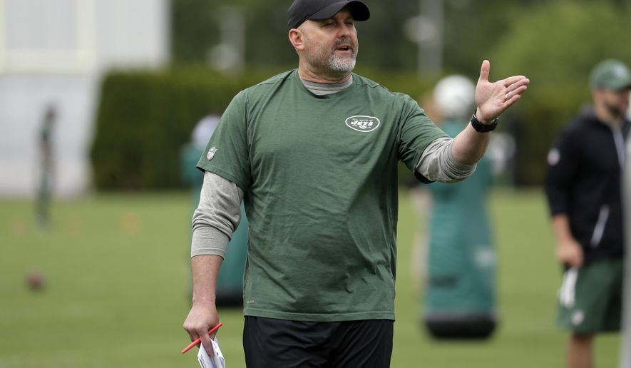 FILE - In this May 23, 2017, file photo, New York Jets offensive coordinator John Morton talks to his team during the team's organized team activities at its NFL football training facility in Florham Park, N.J. Morton is prepared to tackle what is widely considered one of the toughest tasks in the NFL this season: making the Jets competitive on offense. (AP Photo/Julio Cortez, File)