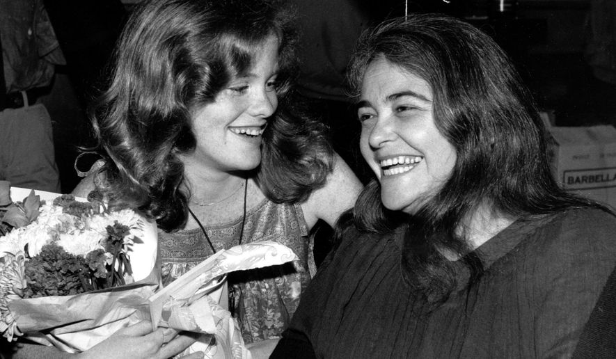 "FILE  - In this May 21, 1979 file photo, feminist activist Kate Millett, right, laughs, during a surprise birthday party for her niece, Kristan Vigard, in New York. Millett, the activist, artist and educator whose best-selling ""Sexual Politics"" was a landmark of cultural criticism and a manifesto for the modern feminist movement, has died at 82, it was reported on Thursday, Sept. 7, 2017. (AP Photo/Ron Frehm, File)"
