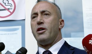 FILE - In this file photo dated Sunday, June 11, 2017, Ramush Haradinaj, candidate for Prime Minister, speaks to media reporters after casting his ballot during the early parliamentary elections Pristina, Kosovo.  The ex-prime minister of Kosovo and former guerrilla fighter, Haradinaj was nominated Thursday Sept. 7, 2017, as the country's new premier and tasked with creating a new Cabinet.(AP Photo/Visar Kryeziu, FILE)