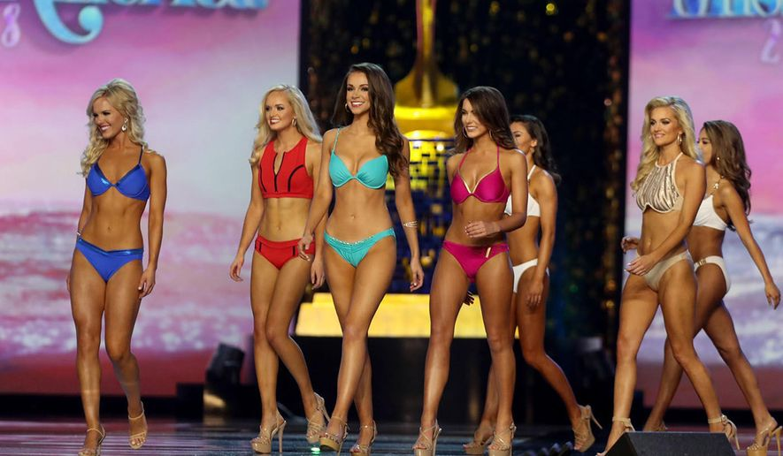 Miss America 2018 contestants walk the stage during the fitness competition during the second night of preliminaries at Boardwalk Hall, in Atlantic City, N.J. Thursday, Sept, 7, 2017. (Edward Lea/The Press of Atlantic City via AP)