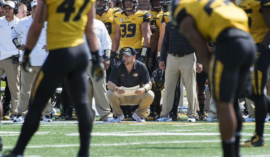 FILE - In this Sept. 2, 2017, file photo, Missouri head coach Barry Odom watches his team play during the first quarter of an NCAA college football game against Missouri State, in Columbia, Mo. Despite an opening win, Missouri came away more concerned than ever about a defense that allowed nearly 500 yards and 43 points to a Football Championsihp Subdivision opponent. (AP Photo/L.G. Patterson, File)