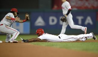 Washington Nationals' Michael Taylor, right, steals second against Philadelphia Phillies shortstop Freddy Galvis, left, during the second inning of a baseball game, Thursday, Sept. 7, 2017, in Washington. (AP Photo/Nick Wass)
