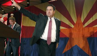 FILE - In this Nov. 4, 2014 file photo Arizona Republican Attorney General Mark Brnovich waves to supporters at the Republican election night party in Phoenix. Attorneys general in 20 Republican states are urging the U.S. Supreme Court to allow the release of videos made by an anti-abortion group whose leaders are facing felony charges in California for recording people without permission. The friend-of-the-court brief filed by Brnovich, on Thursday, Sept. 7, 2017, says the justices should lift an order from the 9th U.S. Circuit Court of Appeals barring the recordings' release. They were made by the Center for Medical Progress at meetings of an abortion provider association. (AP Photo/Ross D. Franklin, File)