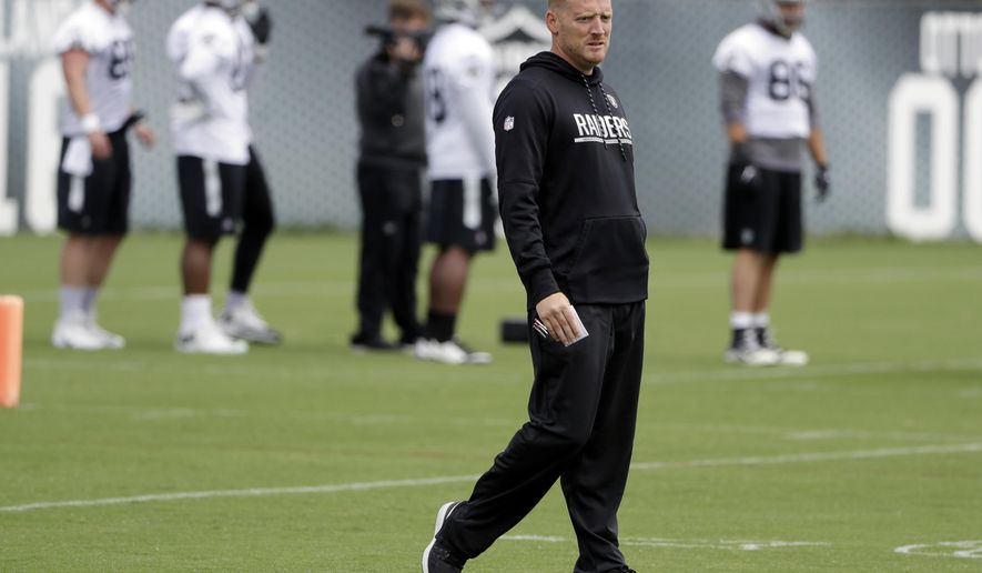 FILE - In this May 30, 2017, file photo, Oakland Raiders offensive coordinator Todd Downing watches drills during the team's organized team activity at its NFL football training facility in Alameda, Calif. Downing has spent the past two years building up a relationship with Derek Carr as his quarterbacks coach. The two play golf, talk current events and most importantly immerse themselves in all aspects of football. With Downing heading into his first game as NFL play-caller following an offseason promotion to coordinator, the hope is the strength of that relationship will pay big dividends on the field. (AP Photo/Marcio Jose Sanchez, File)
