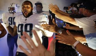 FILE - In this Aug. 19, 2017, file photo, Tennessee Titans defensive end Jurrell Casey (99) greets fans as they take the field before an NFL football preseason game against the Carolina Panthers, in Nashville, Tenn. The only sound Pro Bowl defensive lineman Jurrell Casey likes to hear on a sack is a quarterback's pads smacking the ground. Well, the Titans have put together quite a group of defenders used to doing just that, and Oakland's Derek Carr is their first target. (AP Photo/James Kenney, File)