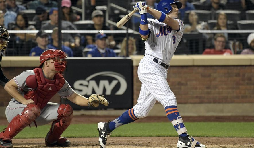 New York Mets' Brandon Nimmo watches his two-run home run in front of Cincinnati Reds catcher Stuart Turner during the sixth inning of a baseball game Thursday, Sept. 7, 2017, in New York. (AP Photo/Bill Kostroun)