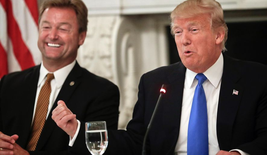 FILE - In this July 19, 2017, file photo, President Donald Trump gestures towards Sen. Dean Heller, R-Nev. while speaking during a luncheon GOP leadership in the State Dinning Room of the White House in Washington. On immigration, there were few easy answers for the Republican Party's most vulnerable members. And President Donald Trump just made things harder. Heller, considered one of the nation's most vulnerable Republicans, broke from Trump this week on the program known as Deferred Action for Childhood Arrivals, or DACA. (AP Photo/Pablo Martinez Monsivais, File)