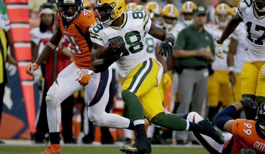 FILE - In this Aug. 26, 2017, file photo, Green Bay Packers running back Ty Montgomery (88) runs as Denver Broncos cornerback Aqib Talib (21) pursues during the first half of an NFL preseason football game, in Denver. Montgomery, the converted receiver, going into his first full season as a running back. The Packers take on the Seattle Seahawks on Sunday. (AP Photo/Jack Dempsey, File)