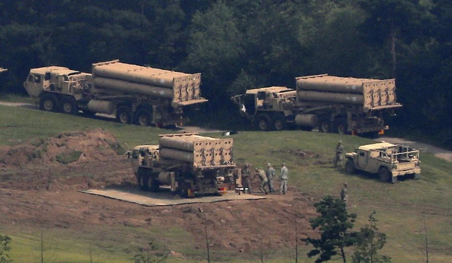 U.S. missile defense system called Terminal High-Altitude Area Defense system, or THAAD, are seen at a golf course in Seongju, South Korea, Thursday, Sept. 7, 2017. Seoul's Defense Ministry on Thursday said the U.S. military has completed adding more launchers to a contentious U.S. missile-defense system in South Korea to better cope with North Korean threats. The deployment of the Terminal High-Altitude Area Defense system has angered North Korea but also China and Russia, which see the system's powerful radar as a threat to their own security. (Kim Jun-beom/Yonhap via AP)
