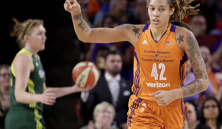 Phoenix Mercury center Brittney Griner (42) points to a teammate after scoring during the first half of a first-round WNBA playoff basketball game against the Seattle Storm, Wednesday, Sept. 6, 2017, in Tempe, Ariz. (AP Photo/Matt York)